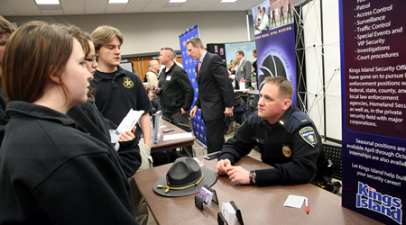 students looking at booths at a career expo