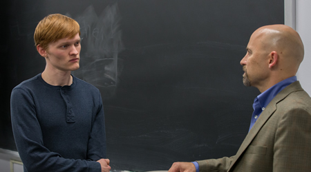Student talking with a professor
