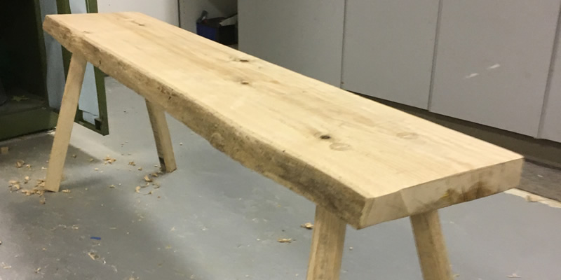 A single bench that was made during the woodworking class.