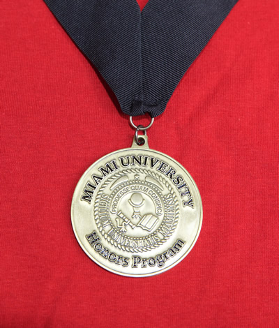 Gold-colored Honors medallion with University seal.