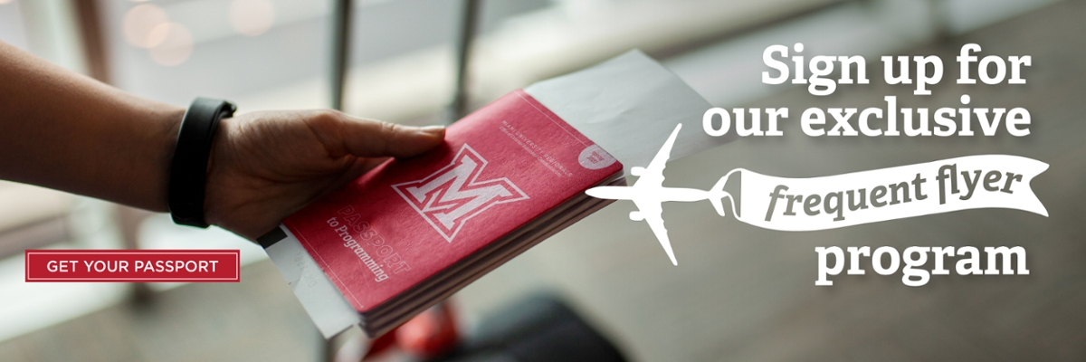 Sign Up for Our Exclusive Frequent Flyer Program. Get your passport. A hand holding a passport in front of luggage.