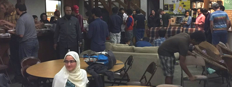 Muslim students and families line up for food at an Eid celebration