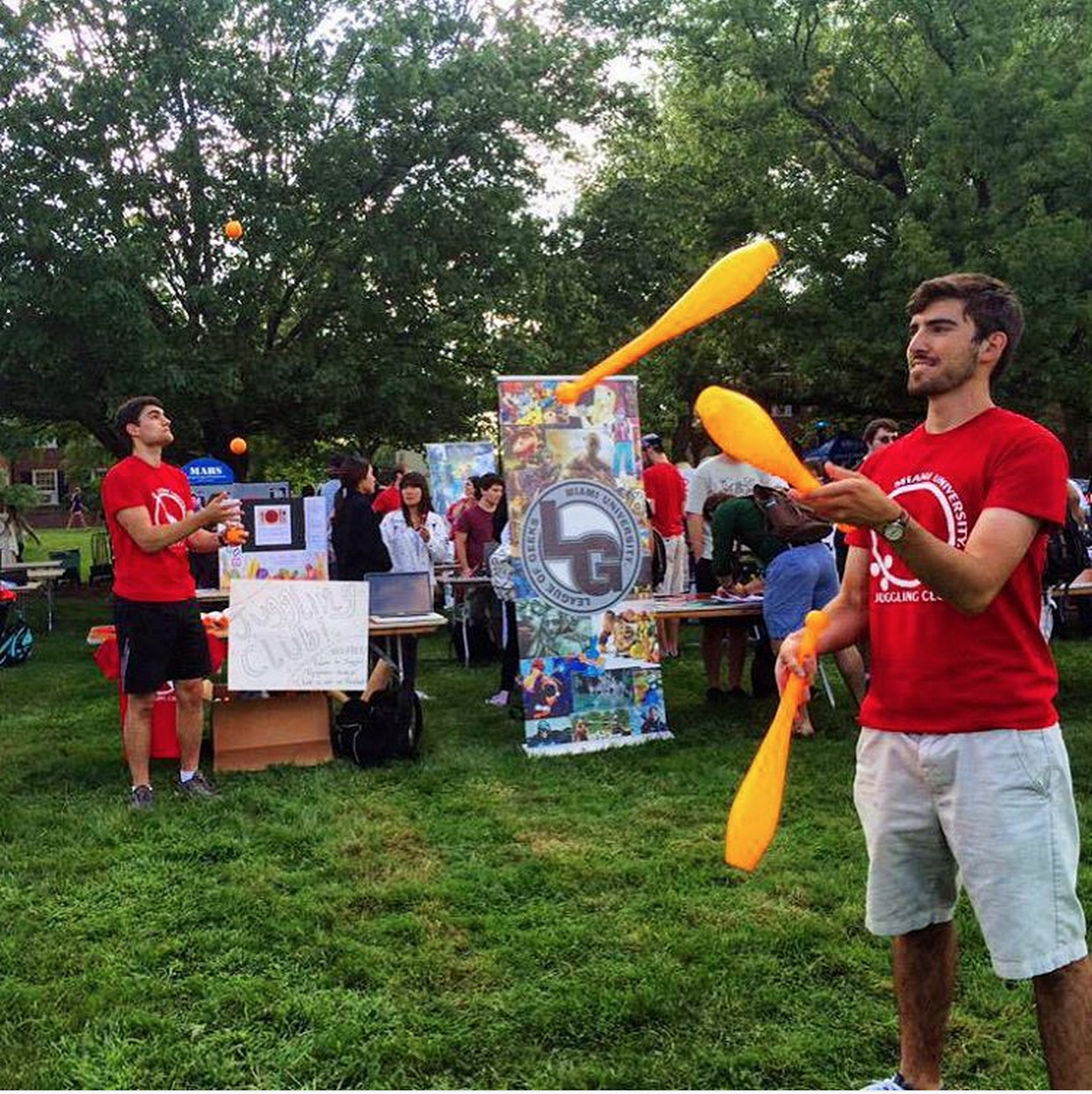Two students from Miami's Juggling Club juggle during the Megafair event on campus.